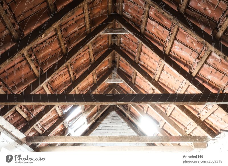 Looking up at the ceiling of an old barn with old roof tiles and wooden beams background grunge design abstract frame retro house pattern sport vintage summer