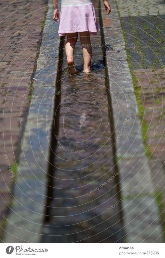 Human being Child Vacation & Travel City Water Summer Girl Joy Cold Feminine Playing Stone Legs Feet Infancy Walking
