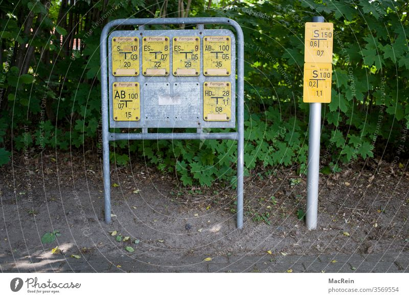 Signs for the course of a natural gas pipeline in the energy sector notice boards signposts pipe routing Gas supply facilities management bodies Energy Yellow
