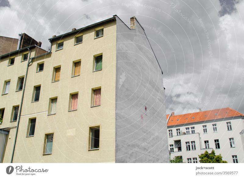 Calm before the storm in the neighbourhood Neukölln Town house (City: Block of flats) Facade Architecture Fire wall Clouds Window apartment building Backyard