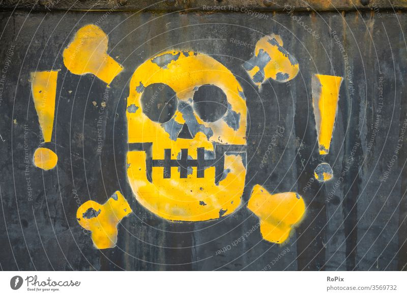 Abstract skull on an industrial plant. smoke fire exit safety Emergency exit message sign Warn Smoking Wall (barrier) bricks unauthorized Red premises Steel