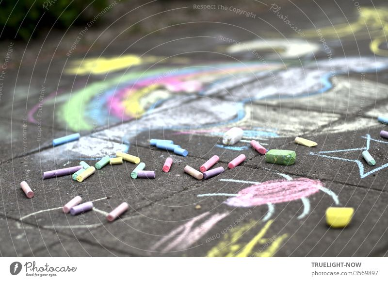 A cheerful, colourful childhood dream in soft pastel colours spread out on the cold, grey stones, coloured pieces of chalk were still lying around, but the artist had made herself invisible