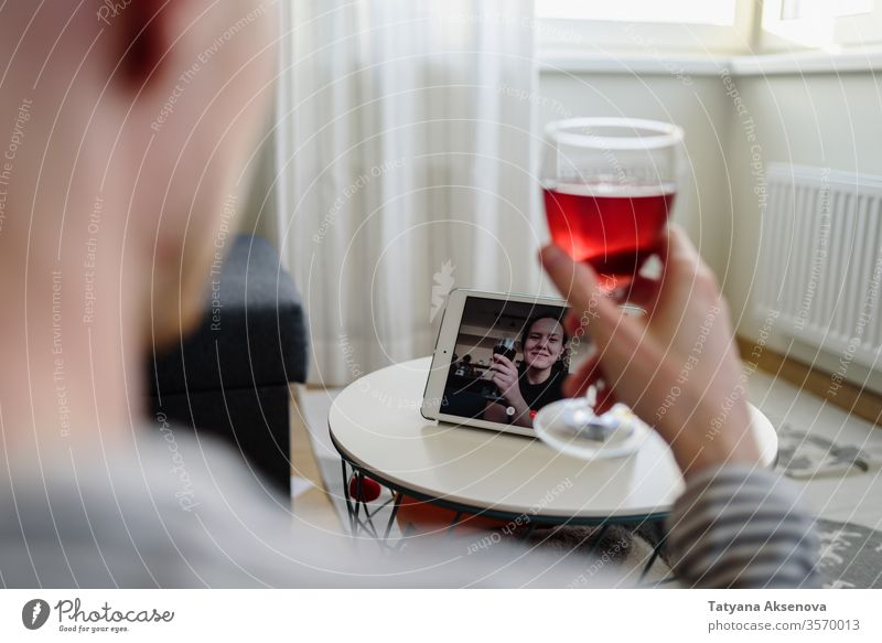 Man drinking wine online with female friend internet lifestyle woman home technology distancing quarantine together happy glass person modern alcohol