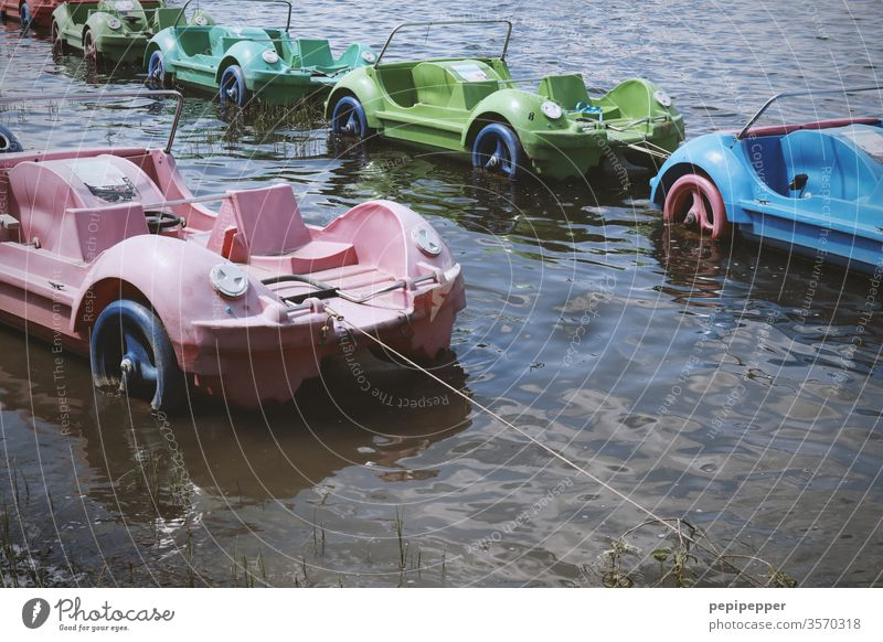 old pedal boats on a lake Pedalo Water Watercraft Lake Summer Swimming & Bathing Exterior shot Leisure and hobbies Trip Vacation & Travel Colour photo