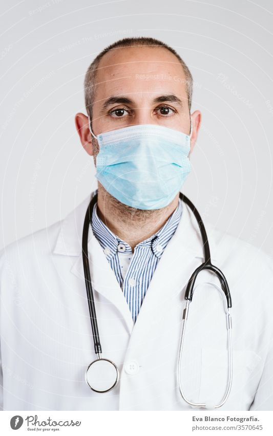 close up view of doctor man wearing protective mask, gloves and stethoscope. Coronavirus Covid-19 concept portrait professional corona virus hospital working