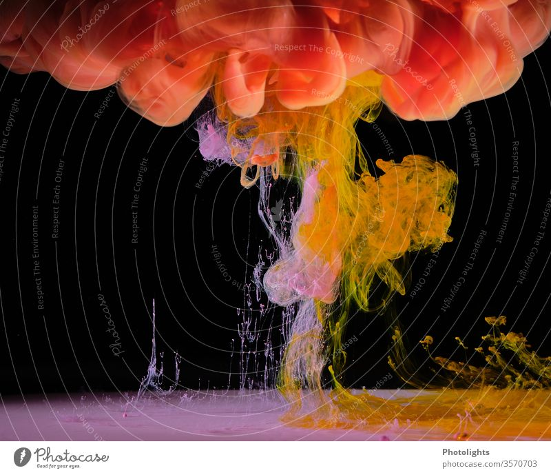 Water feature with yellow, pink and orange colour on black background Yellow Black Play of colours Background picture Art Structures and shapes Colour photo