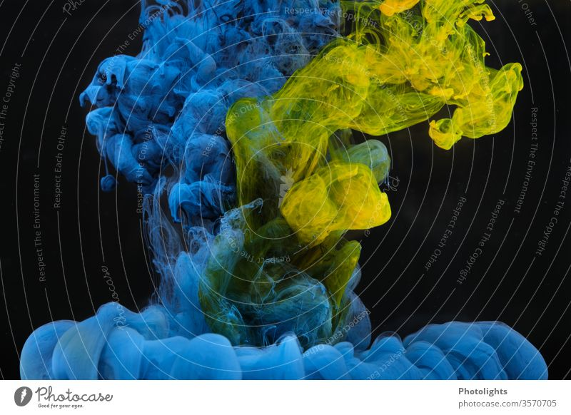 Water feature with yellow and blue paint on black background Yellow Blue Black Play of colours Background picture Art Structures and shapes Colour photo