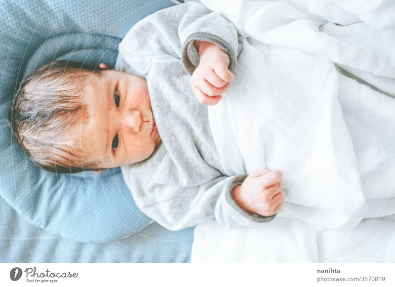 Little new born girl lying down and trying to relax baby birth first day boy mom familly happy happiness care love child daughter son tired sleep sleeping dream