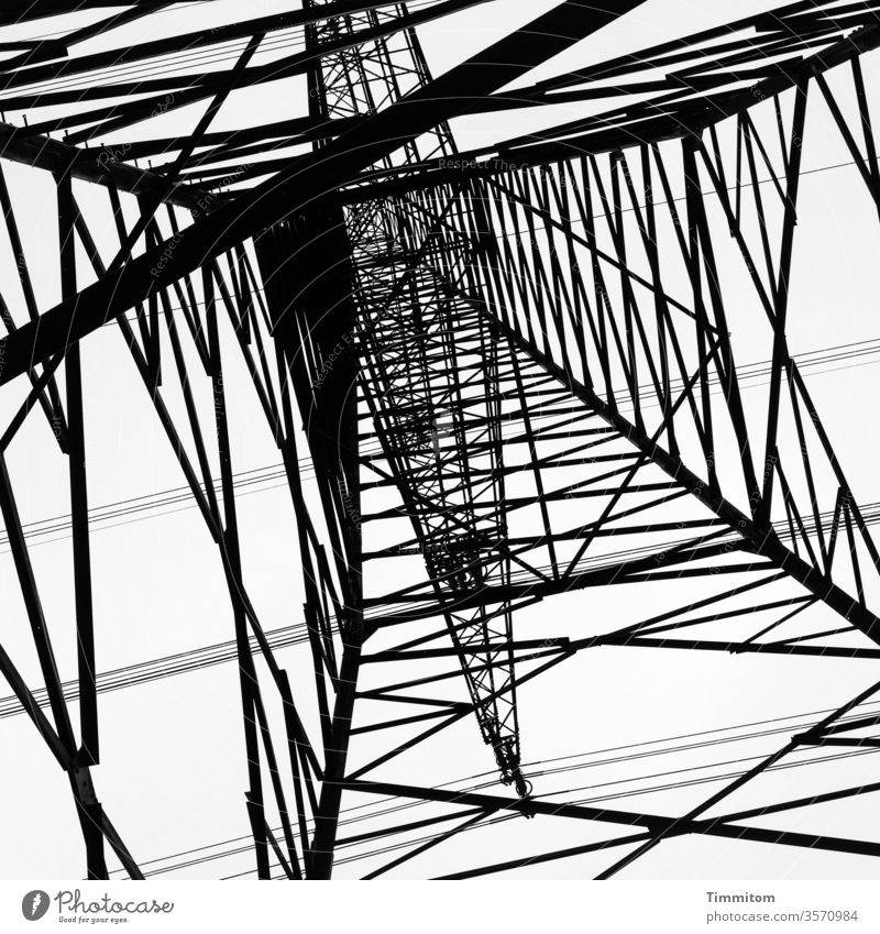 Stand under the power pole and imagine that up there in the square Electricity pylon Pole Metal Construction Sky Technology Energy industry