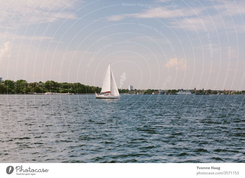 Sailing tour on the sea Sand Beach Ocean Water Waves Surf Coast Sky Blue Clouds Horizon Nature Far-off places Landscape White Beautiful weather Summer Day