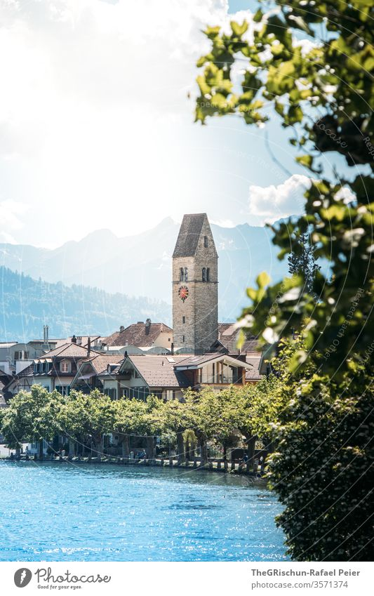 View of church in Interlaken (Switzerland) Tourism Church River tree Exterior shot Colour photo Deserted Day Vacation & Travel Trip Summer Landscape mountains