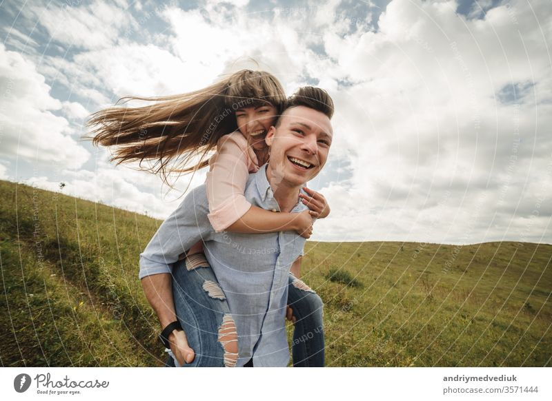 crazy young couple emotionally having fun, kissing and hugging outdoors. Love and tenderness, romance, family, emotions, fun. having fun together beach happy