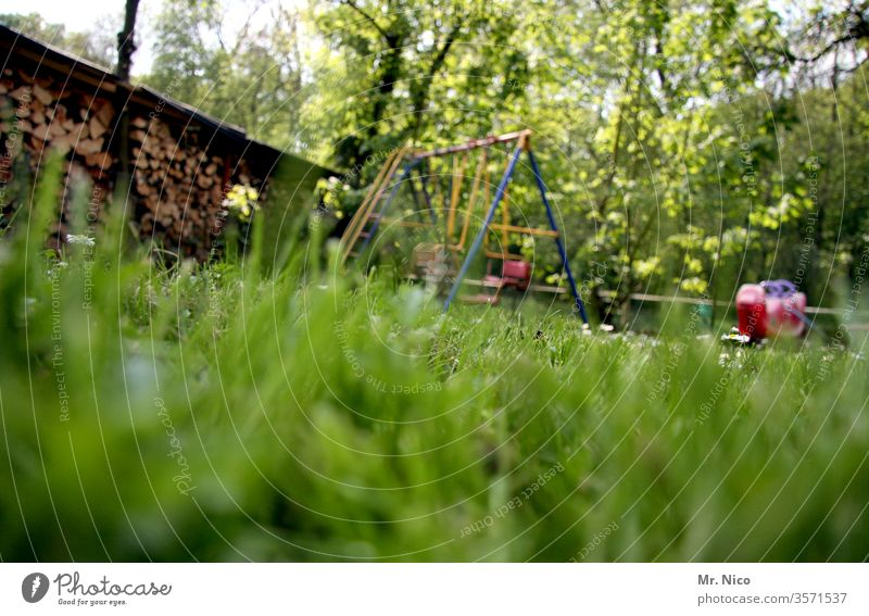 in the garden Garden Meadow Lawn Grass green Summer Nature Plant Garden plot Swing To swing Playing Worm's-eye view Relaxation Idyll Stack of wood Seesaw