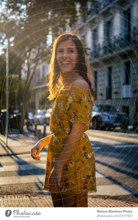 Portrait of a cute model at golden hour, wearing a yellow dress of flower print. portrait fashion bokeh lifestyle lights woman glamour Lifestyle