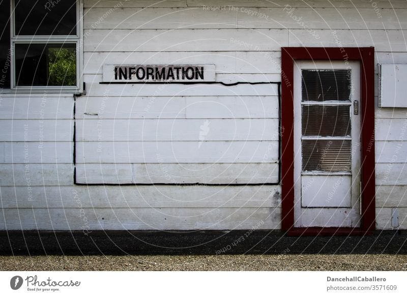 Wooden wall with sign Information Advice Communication Signs and labeling Signage Characters Wall (building) door Window Clue Communicate experienced Know