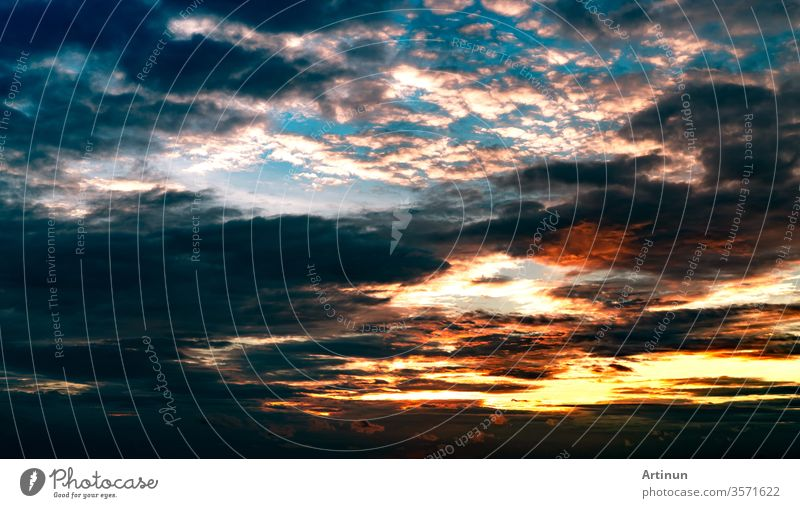 Beautiful sunset sky. Orange, blue, and white sky. Colorful sunset. Art picture of sky at sunset. Sunset and clouds for inspiration background. Nature background. Peaceful and tranquil concept.