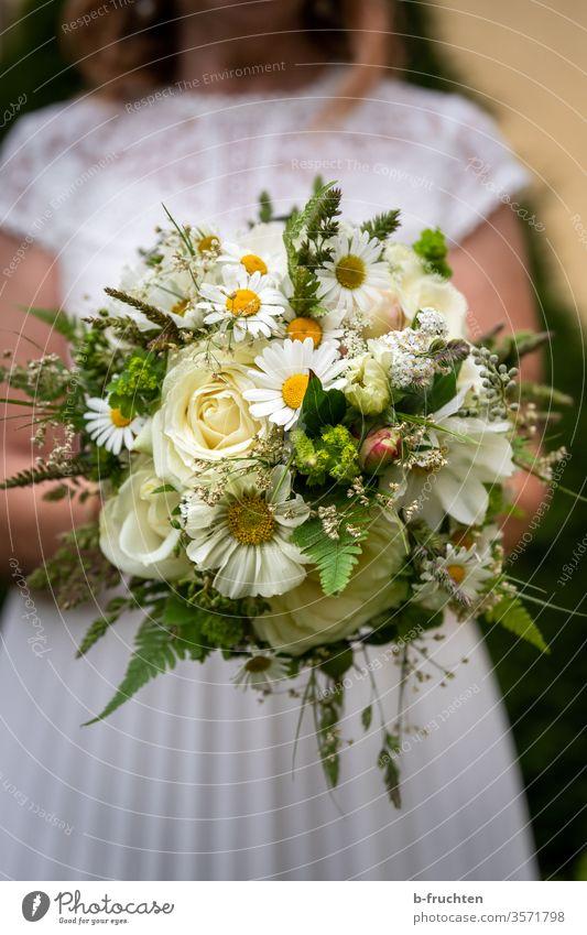 Bride holding bridal bouquet Wedding Love Bouquet Colour photo Exterior shot already Romance Feasts & Celebrations White Woman Happiness Adults flowers Elegant