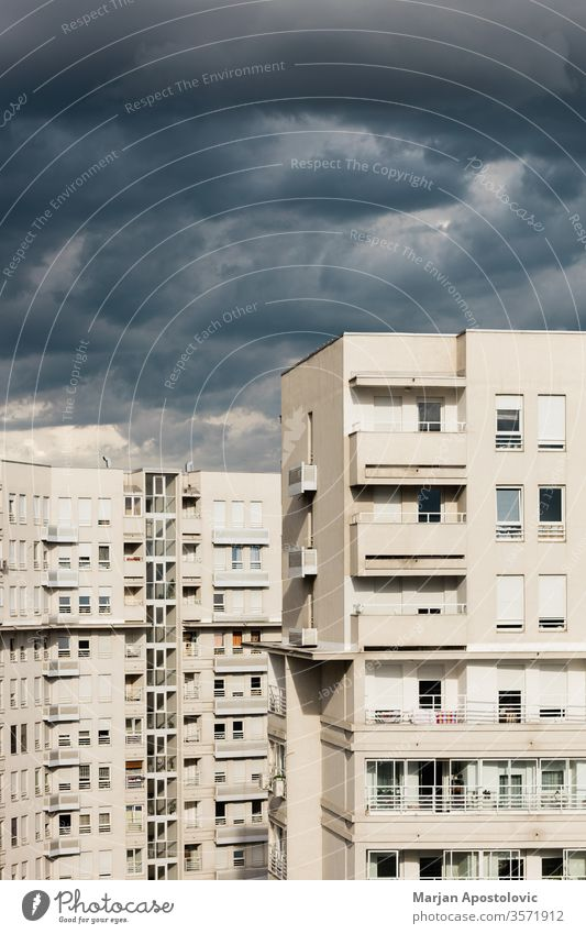 Stormy clouds over the residential buildings apartment architecture bad city cityscape cloudscape cloudy concept condominium cumulus danger dark district