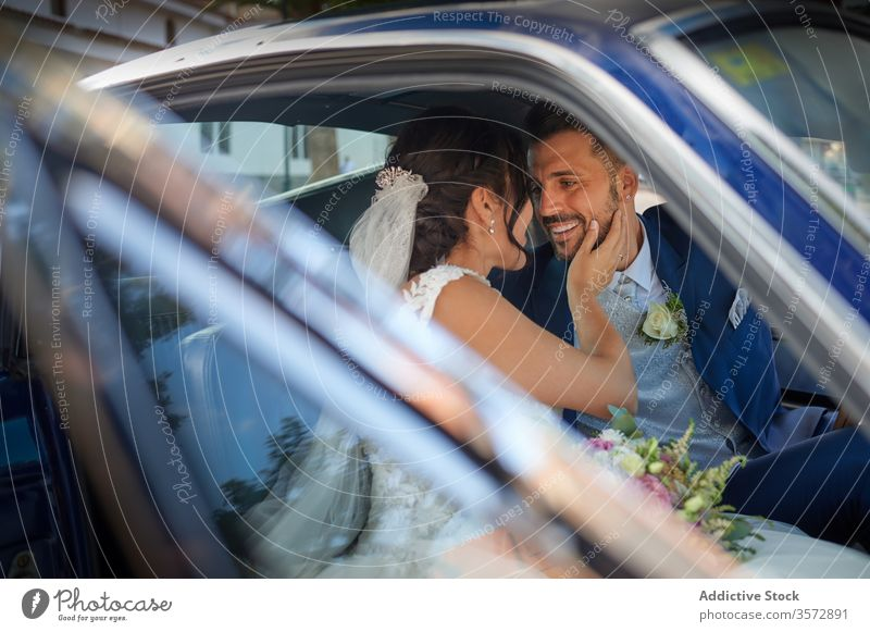 Delighted newlywed couple in luxury car bride groom wedding dress classy suit happy delight smile cheerful content sit vintage retro automobile shiny tuxedo