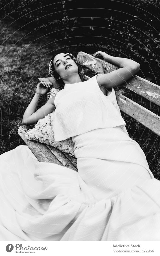 Young bride sleeping on bench woman park wedding elegant concept ceremony rest female young dress lying relax tranquil serene idyllic style event romantic lady
