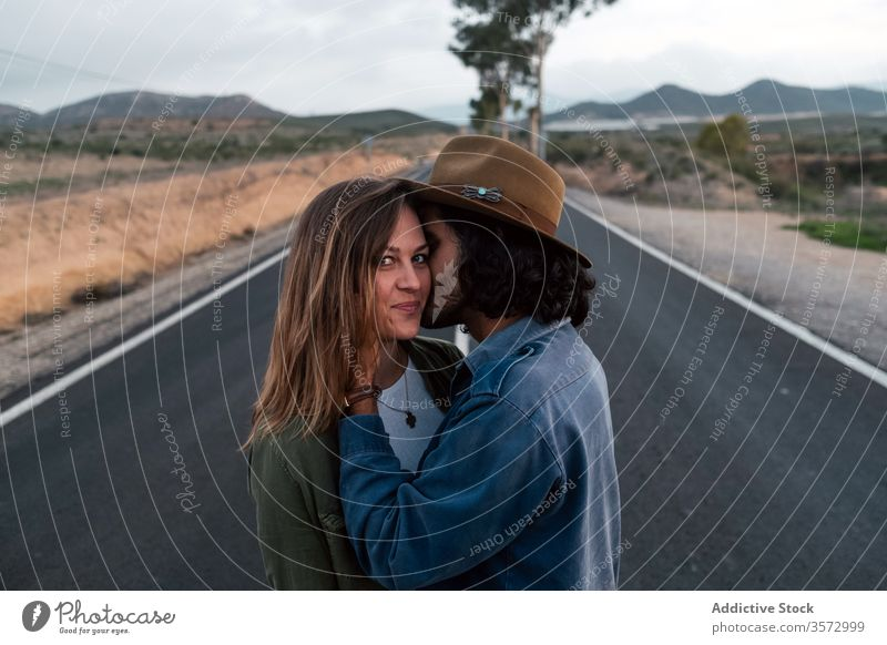 Couple hugging on countryside road couple date love sky cloudy trip together man woman affection casual asphalt romantic relationship girlfriend boyfriend