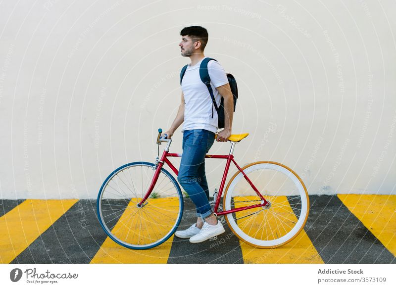 Caucasian man riding a fixie bicycle bike urban wheel fixed sport transportation gear lifestyle wall street hipster ride pedal biking chain action cyclist