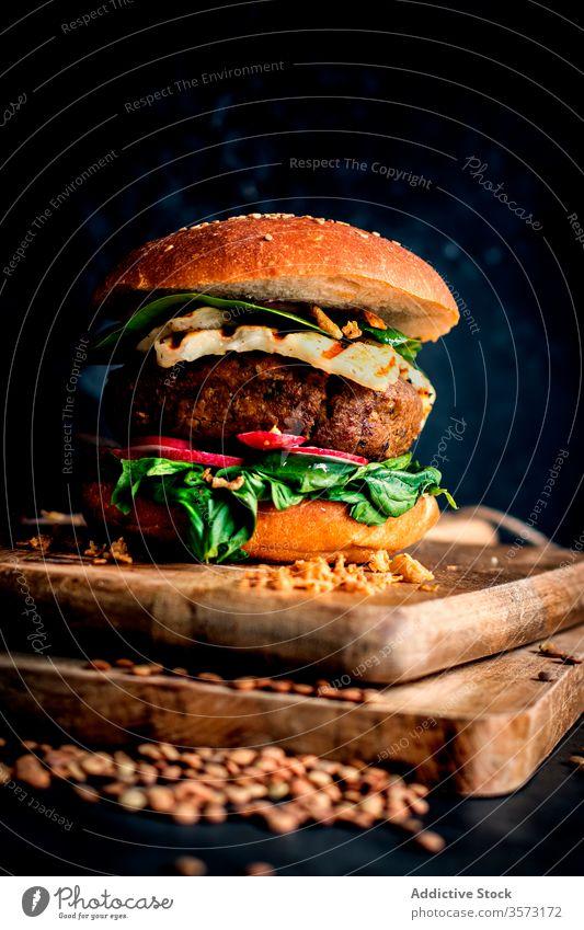 Lentils vegan hamburgers placed on wooden board on dark background gourmet lentil burger veggie burger fast food eating baked delicious natural lifestyle