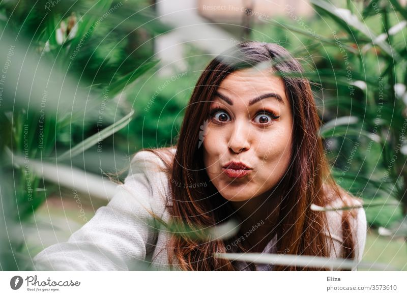 Young woman makes a duckface grimace and looks surprised into the camera Duckface portrait Grimace Woman youthful pretty astonished Amazed bunkum girl Face