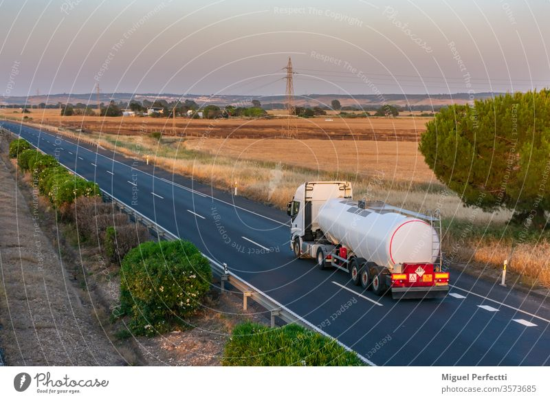 Tank truck with heat-insulated semi-trailer for the transport of liquids at high temperatures circulating on the highway. tank truck dangerous goods