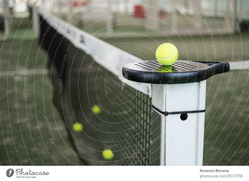 Paddle tennis racket and balls on court still life paddle tennis padel close up close-up pádel sport cut off white objects sports recreation no people nobody