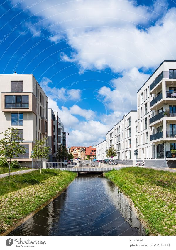 Modern buildings and canal in the Hanseatic City of Rostock Historic House (Residential Structure) built Channel Petriquette bridge Town