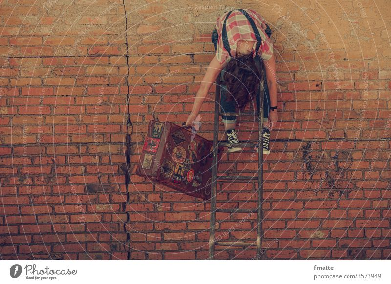 Woman hanging over a ladder with suitcase voyage Suitcases Wait Droop Ladder Rung vacation
