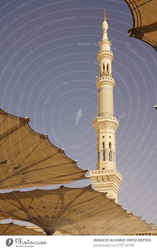Medina mosque minaret and sun umbrellas wanderlust wonder human icon slim harmonic beauty islamic art culture city holy place holiday travel icons pilgrimage