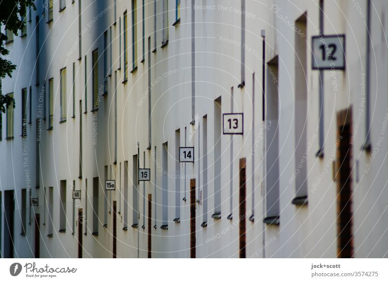 House numbers from 16a to 12 in one street Facade Arrangement Perspective Digits and numbers Wall (building) apartment building Architecture Row typo Sequence