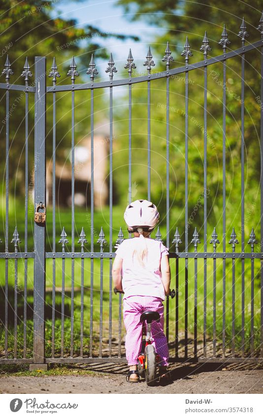 at locked gates girl closed Goal door Fence Grating too Bicycle Cycling No trespassing completed Padlock Lock Castle grounds Private private premises Looking