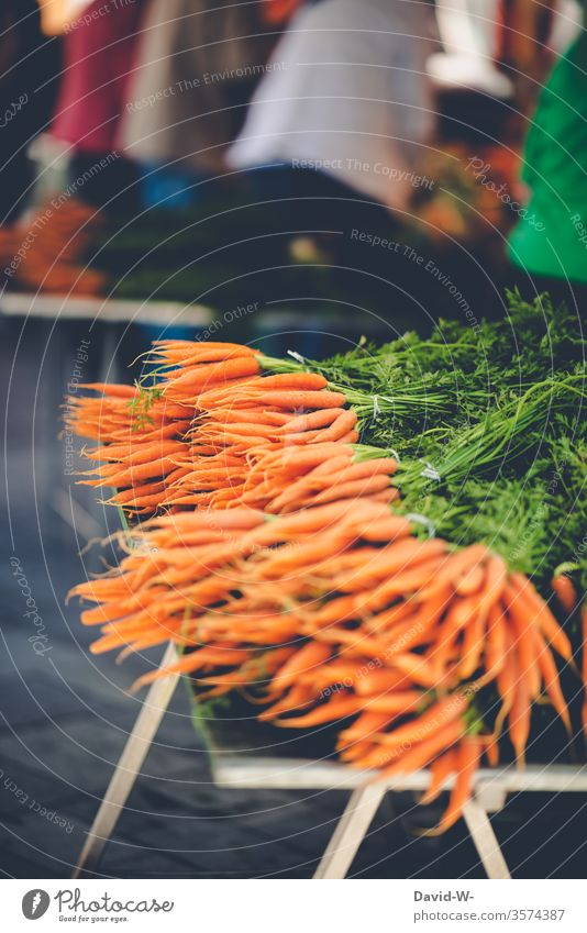 Weekly market - fresh carrots Marketplace Farmer's market Vegetable Market stall Sustainability salubriously Organic produce Merchant consumer buyer Seller