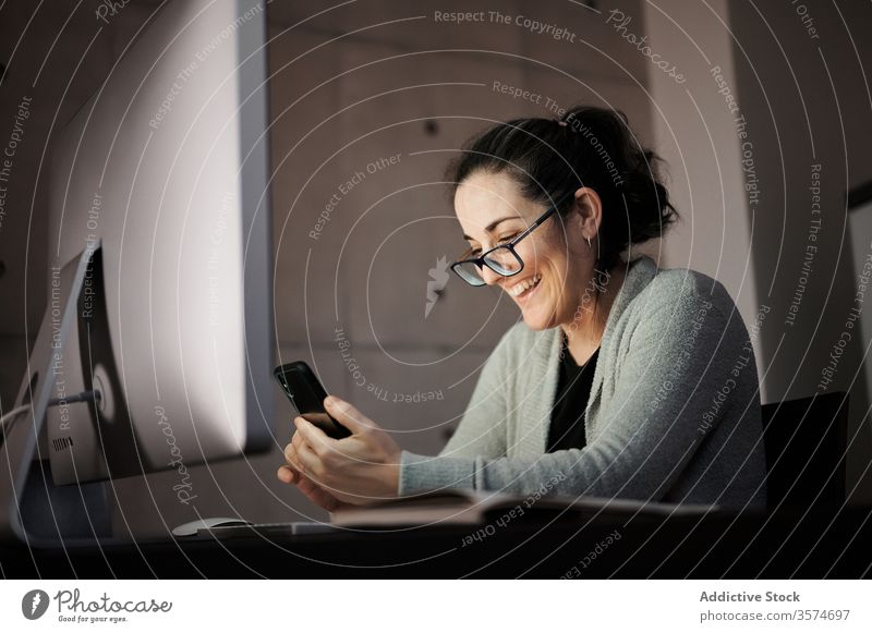 Focused woman working with gadgets at home smartphone computer telework using browsing young casual female serious concentrate focus blank screen empty screen