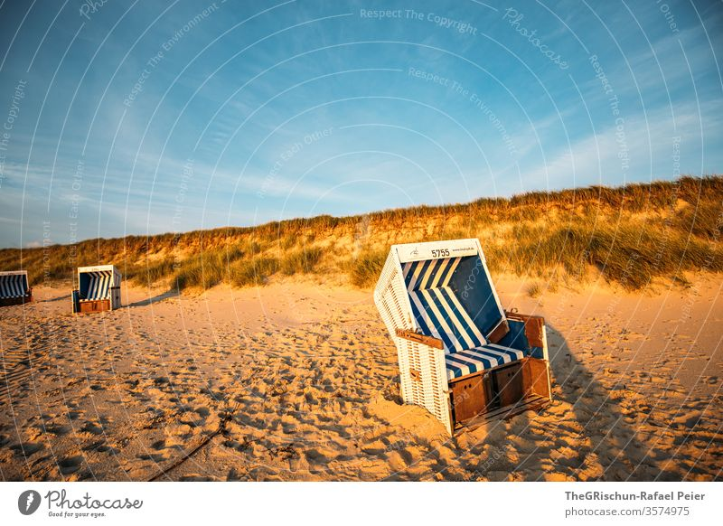 Strandkorb on the beach with dune in the background Sylt Beach vacation Sand Vacation & Travel Beautiful weather North Sea Summer Ocean Water Sky Blue Deserted