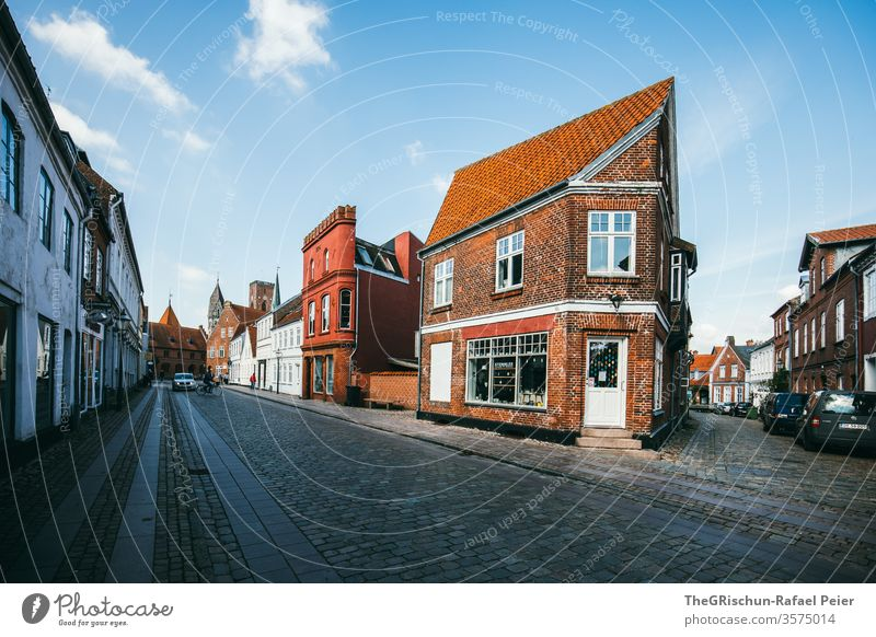 Corner house on a street House (Residential Structure) house cell Ribe Denmark Clouds Sky Exterior shot Blue Vacation & Travel Tourism Street Paving stone