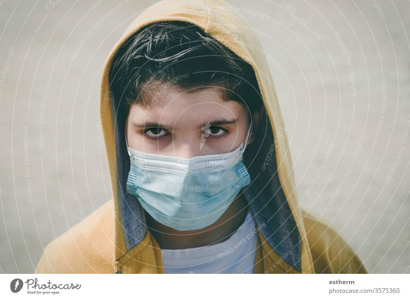 close-up of sad kid wearing medical mask coronavirus child epidemic pandemic thoughtful quarantine covid-19 symptom medicine health death protect childhood