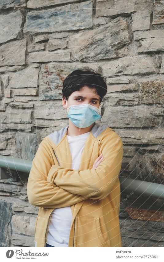 sad and angry kid wearing medical mask coronavirus child epidemic pandemic thoughtful quarantine covid-19 symptom medicine health death protect childhood