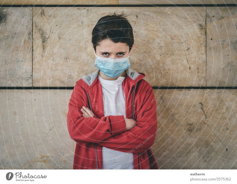 angry kid wearing medical mask coronavirus child epidemic pandemic thoughtful boy quarantine covid-19 symptom medicine health death protect childhood sadness
