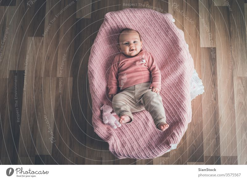 Cute baby lying in the basket, top view. bed white little cute newborn home young child infant kid childhood adorable beautiful pink healthy crib happy care