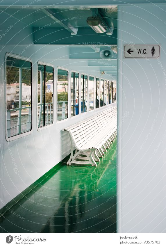 straight ahead the rear of the ferry, immediately on the left a WC Ferry On board Vacation & Travel Navigation Reflection Deck Varnished Cleanliness Glittering