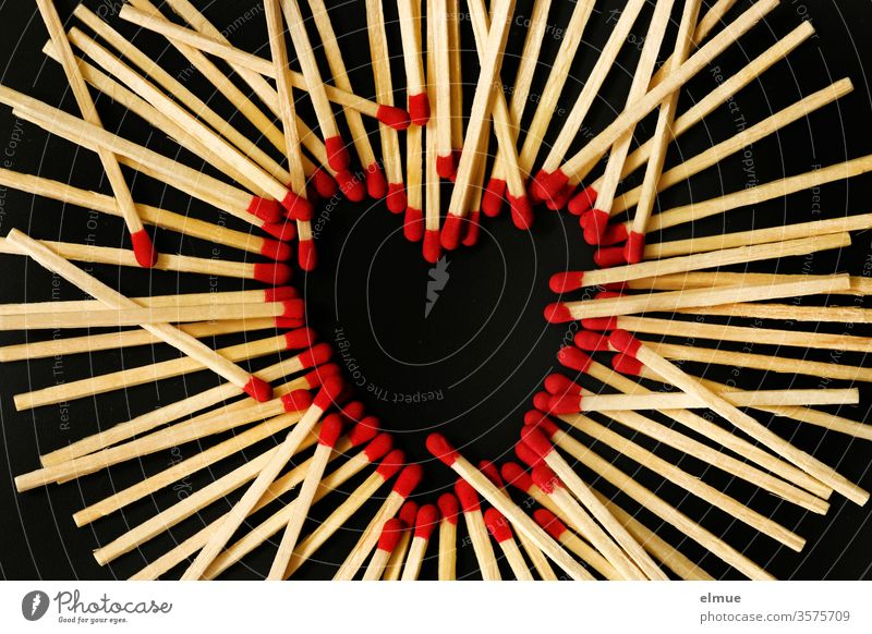 Photochallenge I matches on a black background - red match heads form a heart, other matches lie on top Match Heart disorder Love Burn Hot Ignitions wood Black