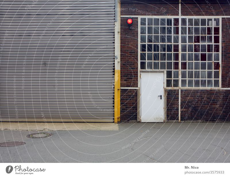 Hall with rolling gate ,door and window Goal Rolling door Window Closed Gray Entrance Building Architecture Storage Warehouse Stock of merchandise