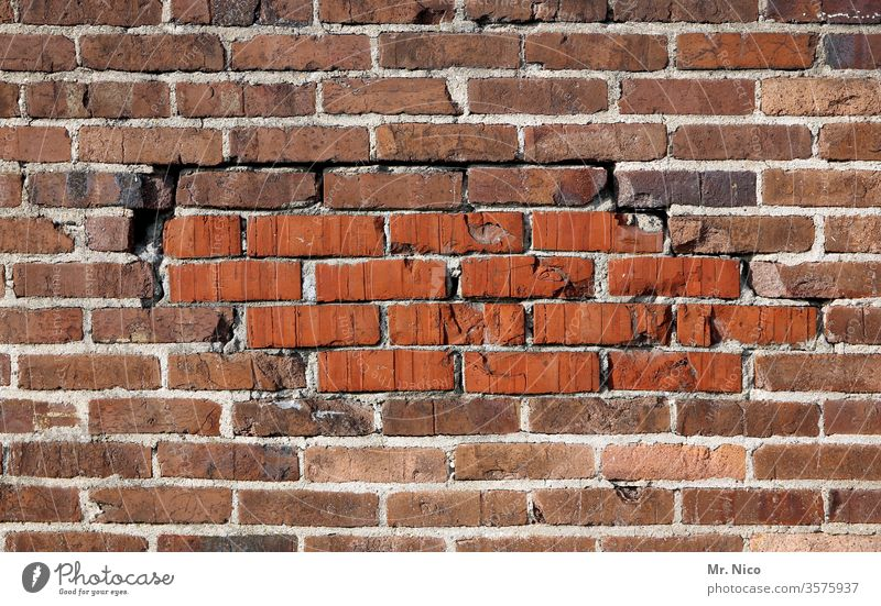 mended wall Masonry Brick rectangular Old Rough Construction Material Solid built Wall (building) Stone Red masonry Build Cement Weathered Dirty structure