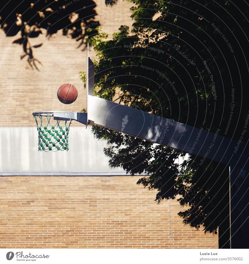 Basketball, red ball in flight to the basket Basketball basket Wall (building) Red Net Facade Colour Brick Brick wall Brick facade Deserted Wall (barrier)