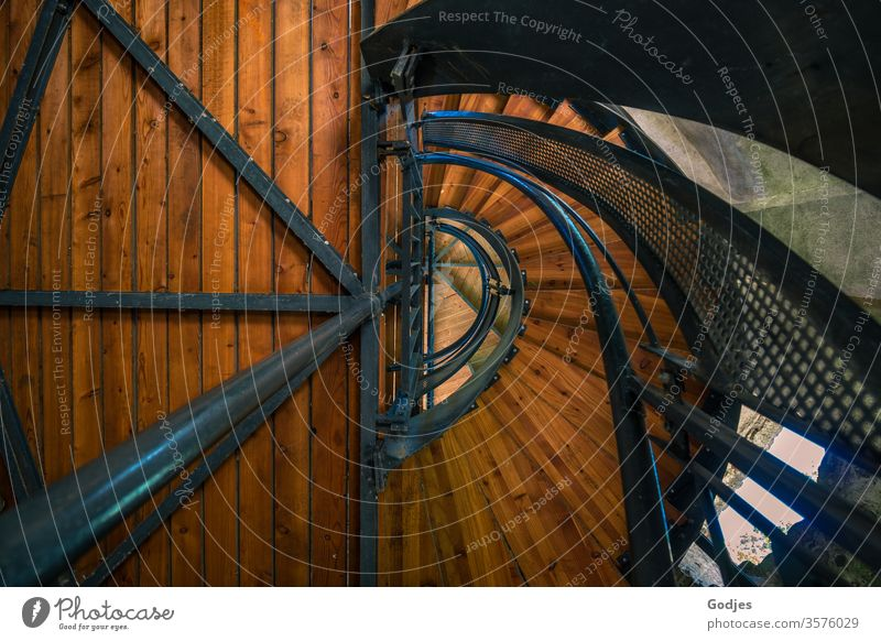 View upwards into a staircase made of wood and metal Stairs Staircase (Hallway) Architecture Banister Interior shot Deserted Colour photo built