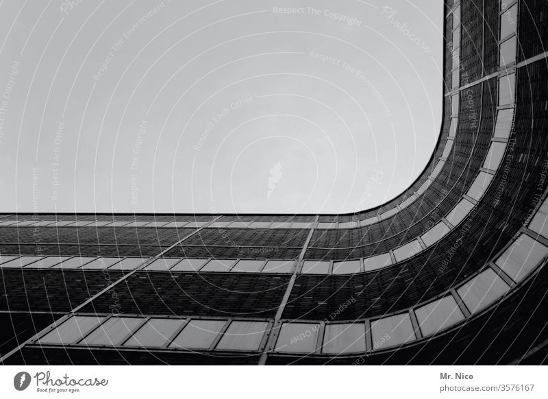 curved Architecture Modern architecture Facade built House (Residential Structure) Window Worm's-eye view Sky Curved Contrast Shadow Construction Town High-rise